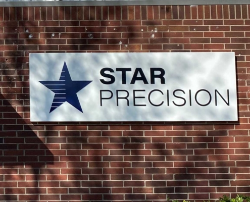 Star Precision Sign